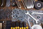 picture of triplets  - Assorted work tools on wood background - JPG