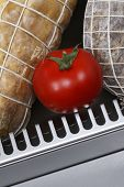 picture of refrigerator  - salami sausages and tomato - JPG