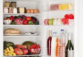 pic of refrigerator  - Interior of a refrigerator full of assorted food - JPG