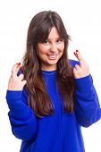 foto of fingers crossed  - Woman with crossed fingers isolated over a white background - JPG
