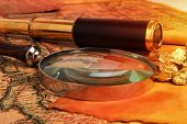 stock photo of gold nugget  - Gold nuggets and vintage brass telescope on antique map  - JPG