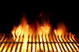 stock photo of charcoal  - Empty Flaming Charcoal Grill With Flames Of Fire On Black Background Closeup - JPG