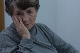 image of suffering  - Portrait of senior woman suffering for depression - JPG