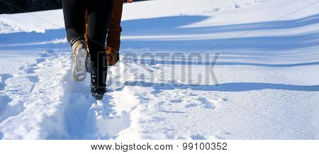 walking on the snow in the mountain. Footprints in the snow. copy space.
