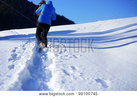 walking on the snow in the mountain. Footprints in the snow.