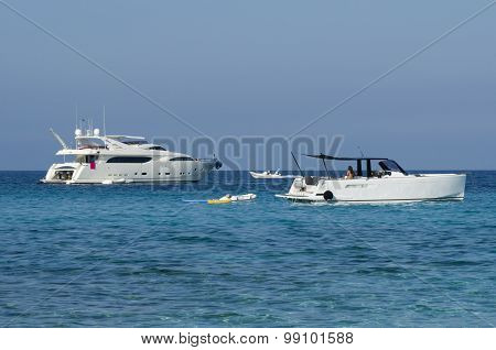 Launches And Yachts Moored Off On A Blue Sea