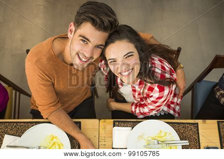 Top view of a young couple at the restaurant having a good time