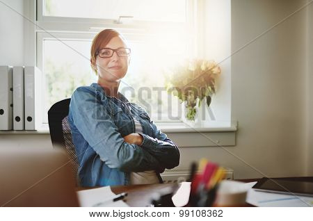 Confident Office Woman Sitting At Her Desk
