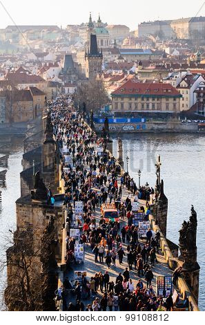 sunset view of Prague old town and Charles bridge over Vltava river, Czech Republic