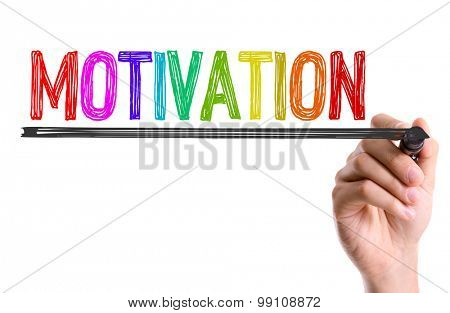 Hand with marker writing the word Motivation