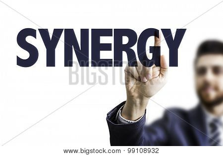 Business man pointing the text: Synergy