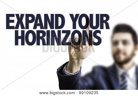 Business man pointing the text: Expand Your Horizons