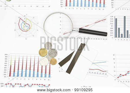 Business Still-life Of A Diagram, Magnifier, Coins, Credit Card