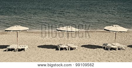 Greece. Kos Island. Chairs And Umbrellas On The Kefalos Beach. In Instagram Style