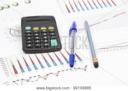 Business Still-life Of A Pen, Pencil, Charts, Calculator