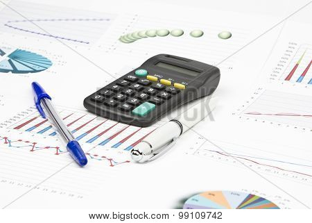 Business Still-life Of A Two Pen, Charts, Calculator