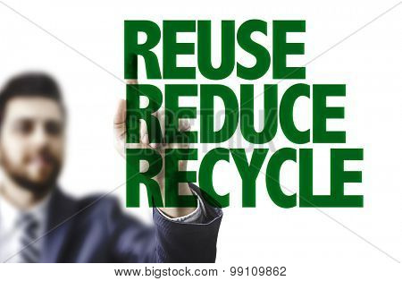 Business man pointing the text: Reuse Reduce Recycle