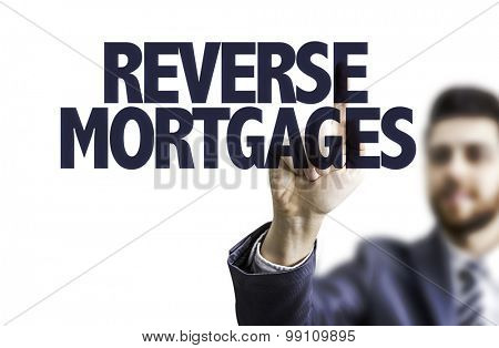 Business man pointing the text: Reverse Mortgages