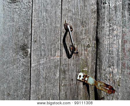 Old Door With Rusty Handle