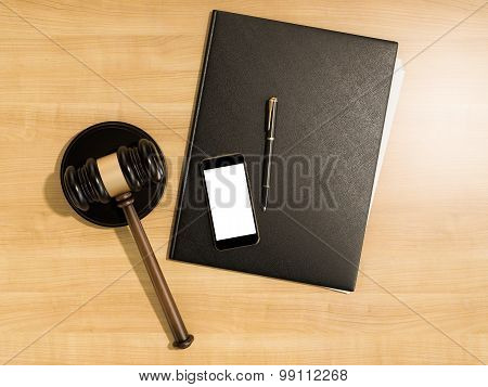 Wooden Judges Gavel And Phone On The Wooden Background