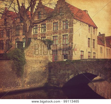 Bruges, Belgium. Photo in retro style. Added paper texture. Toned image