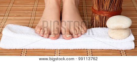 Care for beautiful woman legs on a towel