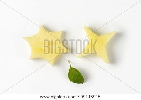 two apple pulp stars and leaf on white background