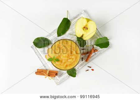 bowl of apple sauce and spice on wooden cutting board