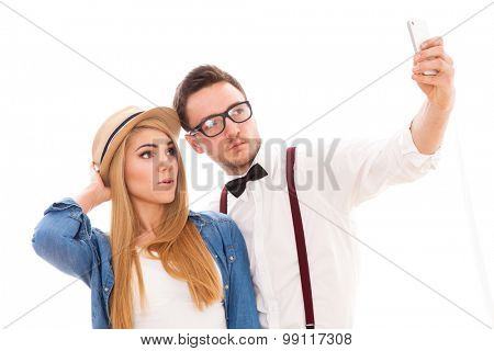 Young beautiful hipster couple making a selfie