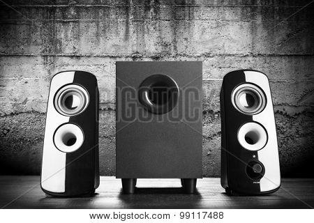 Modern black sound speakers on dark background