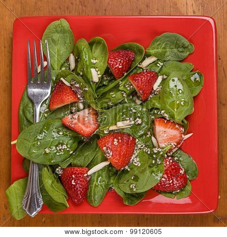 Spinach strawberry salad with homemade poppy seed dressing and almonds.