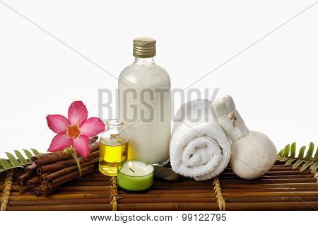 Spa setting with with ,towel, grove, oil, candle on mat