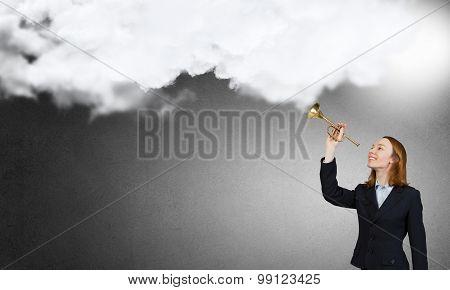 Woman speaking in horn