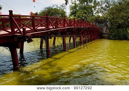 The Huc bridge in Hoan Kiem lake (or Sword Lake) in Hanoi, Vietnam.