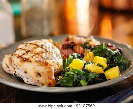 mango kale saiad and beans with grilled chicken breast
