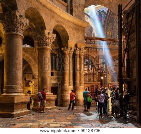 JERUSALEM, ISRAEL - JULY 26, 2015: People inside the Church of the Holy Sepulchre - holy place where according christian tradition Jesus Christ was crucified, buried and resurrected.