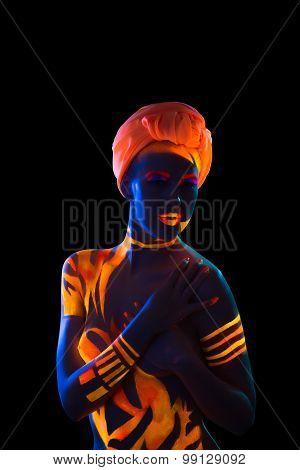 Woman in turban posing under neon light