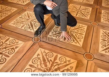 ST. PETERSBURG, RUSSIA - AUGUST 13, 2015: Director of the architectural Bureau Rafael Dayanov shows the fragment of flooring in the restored interiors of the Marble Palace