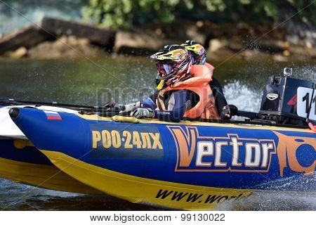 ST. PETERSBURG, RUSSIA - AUGUST 15, 2015: Irina Krylova (in front) and Dmitry Krylov go to start of River marathon Oreshek Fortress race. This international motorboat competitions is held since 2003