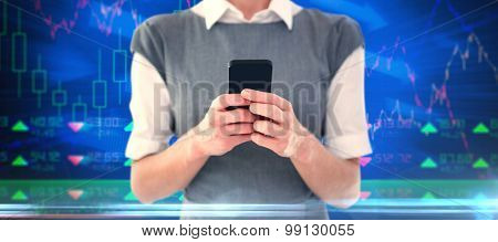 Businesswoman texting against stocks and shares
