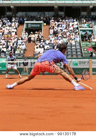 Seventeen times Grand Slam champion Roger Federer in action during match at Roland Garros 2015