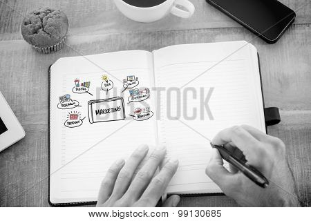 Man writing notes on diary against marketing doodle