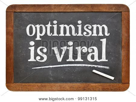optimism is viral - white chalk text on a vintage slate blackboard
