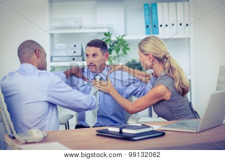 Business partners fighting together in the office