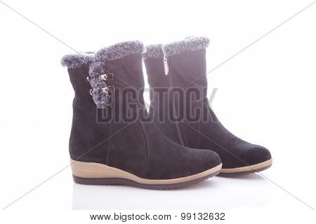 Beautiful, black boots with zips and buckles made of suede. On a white background.