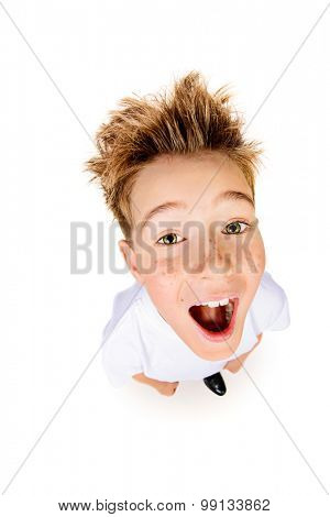A boy in white t-shirt stares into the camera, he is surprised. Isolated over white background.