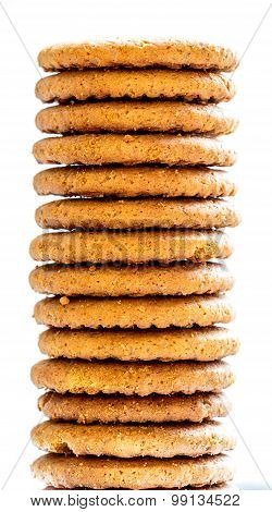 Freshly baked stacked ginger flavour biscuits kept on a blurred background