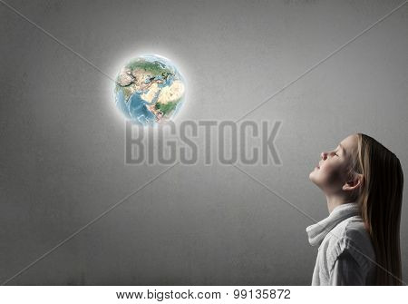 Side view of cute girl and Earth planet above her head. Elements of this image are furnished by NASA