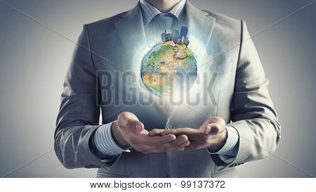 Hands of businessman holding earth planet. Elements of this image are furnished by NASA