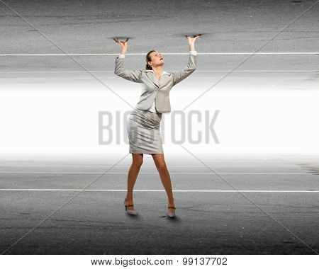 Businesswoman under pressure between two stone walls